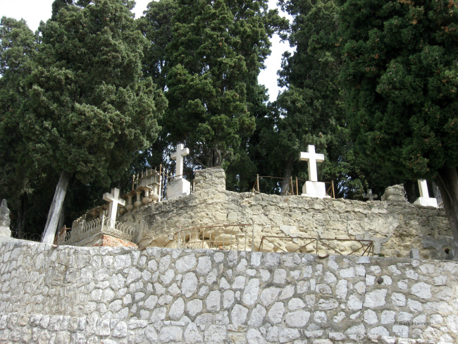 stone wall with the cemetery above